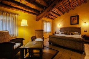 Cama o camas de una habitación en L'Agora Hotel
