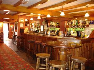 The lounge or bar area at The Four Alls Inn