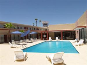 The swimming pool at or near El Dorado Inn Suites - Nogales