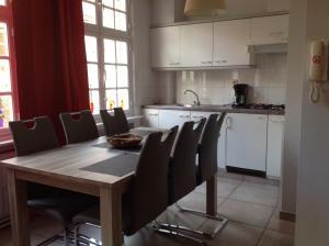 Küche/Küchenzeile in der Unterkunft Holiday Home 't Beertje