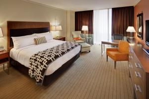 A bed or beds in a room at Fairmont Pittsburgh