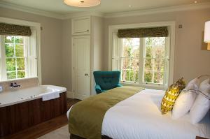 A bed or beds in a room at The Oaksmere Hotel