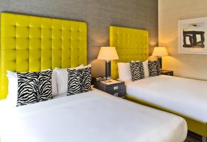 A bed or beds in a room at The Marcel at Gramercy