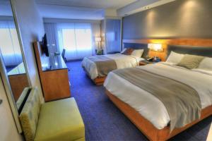 Un ou plusieurs lits dans un hébergement de l'établissement Hotel Forestel