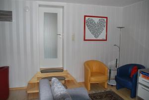 Ein Sitzbereich in der Unterkunft Ferienwohnung Obermühle