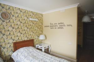 Кровать или кровати в номере Biblioteka Boutique Hotel