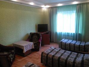 Кровать или кровати в номере Гостевой Дом на Каспийской