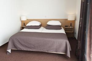 Un ou plusieurs lits dans un hébergement de l'établissement Hotel Ameland