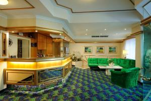 The lobby or reception area at Hotel Scherer