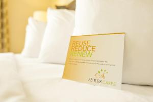 A bed or beds in a room at Ayres Hotel Redlands