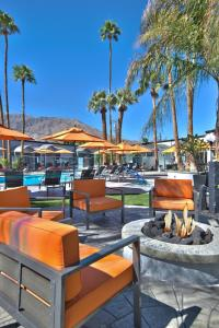 The lounge or bar area at The Palm Springs Hotel