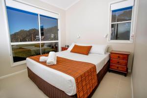 A bed or beds in a room at Reflections Holiday Parks Bonny Hills