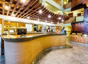 The lobby or reception area at Pizzato Praia Hotel