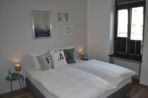 A bed or beds in a room at Stilvoll - Hotel & Restaurant
