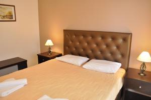Un ou plusieurs lits dans un hébergement de l'établissement Kommeno Bella Vista