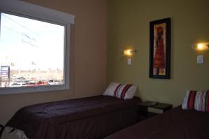 Una cama o camas en una habitación de Hotel Llota Queens en Frias