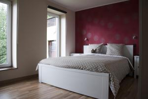 A bed or beds in a room at B&B Die Alte Scheune