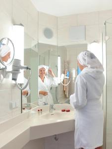 Ein Badezimmer in der Unterkunft Hotel Malchen Garni