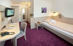 Ein Bett oder Betten in einem Zimmer der Unterkunft Hotel Malchen Garni