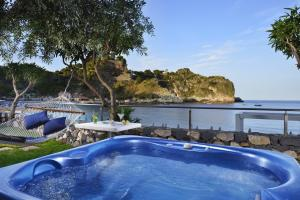 The swimming pool at or near La Plage Resort