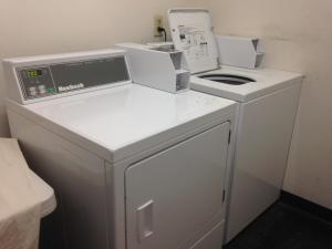 A kitchen or kitchenette at Country Hearth Inn & Suites Augusta
