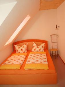 Ein Bett oder Betten in einem Zimmer der Unterkunft Ferienwohnung Prinke