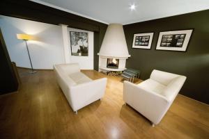 Zona de estar de Hotel Nes