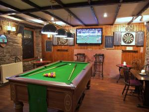 A pool table at Lion and Unicorn Hotel