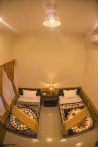Cama o camas de una habitación en Tai House Resort