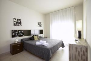 A bed or beds in a room at Ibersol Spa Aqquaria
