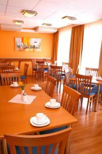 Ein Restaurant oder anderes Speiselokal in der Unterkunft Hotel Evido Salzburg City Center