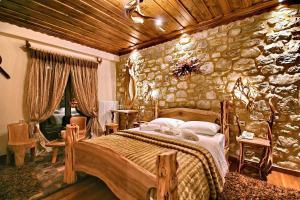 Ένα ή περισσότερα κρεβάτια σε δωμάτιο στο Εν Δημητσάνη