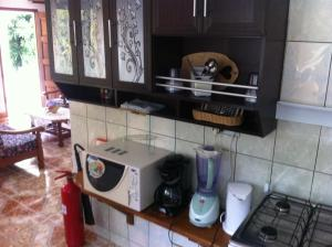 A kitchen or kitchenette at Dan Kazou Self Catering