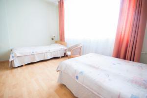 Кровать или кровати в номере Tatari 53 Hotel