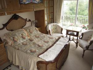 A bed or beds in a room at Killyon Guest House
