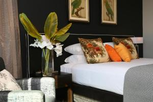A bed or beds in a room at Springfield Lakes Boutique Hotel