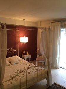 Ένα ή περισσότερα κρεβάτια σε δωμάτιο στο Aerinon Pension