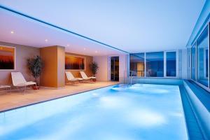 The swimming pool at or near Kaisergarten Hotel & Spa Deidesheim