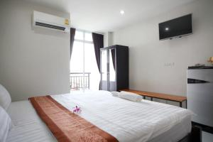 A bed or beds in a room at Paragon One Residence