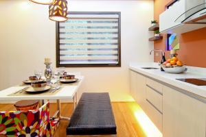 A kitchen or kitchenette at Boracay Suites