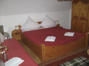 Ein Bett oder Betten in einem Zimmer der Unterkunft Syrtaki bei Nikos