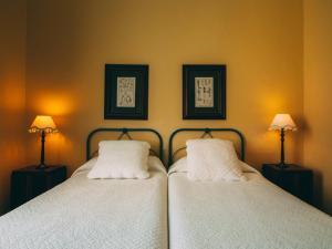 Cama o camas de una habitación en Hotel Rural La Casa Amarilla