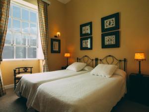 Una habitación en Hotel Rural La Casa Amarilla