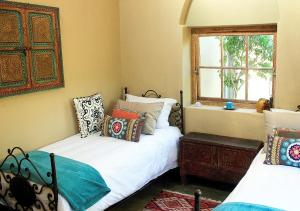 A bed or beds in a room at Akasha Mountain Retreat