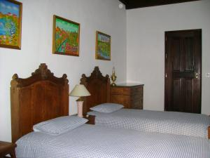 A bed or beds in a room at Herdade De Vale Covo - AgroTurismo