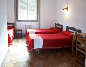 A bed or beds in a room at Casa Diocesana VIA LUCIS