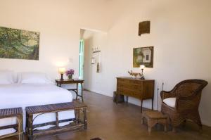 Una cama o camas en una habitación de Posada Paso de los Patos