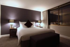 A bed or beds in a room at Renaissance London Heathrow Hotel
