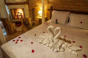 Cama ou camas em um quarto em Pousada Cantinho das Estrelas