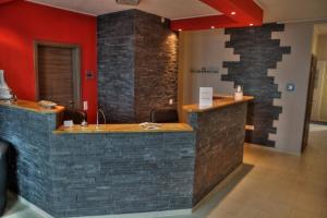 The lobby or reception area at Apado-Hotel garni